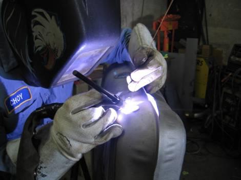 6. Heli-arc welding the tank
