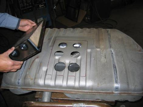 12. This is a gas tank being modified. We are installing a sump that is used for racing. We can also modify fuel tanks for fuel injection vehicles by installing the fuel pump in the tank.